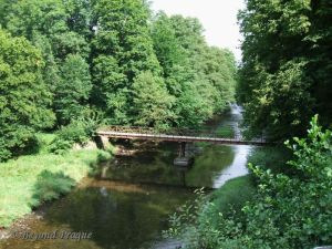 A foot bridge across the Moravice river. Evidence of the many trails in the region.