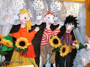 selection of hand puppets on display.