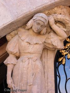 Allegory of Woe, which flanks one side of the chapel's entrance.