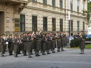 A Czech army band plays music by national composers and finishes with the national anthem.
