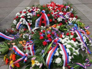 Wreaths at the foot of Masaryk's statue in Brno.