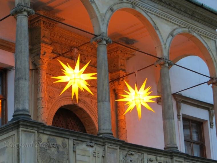 Illuminated stars decorating the town hall.