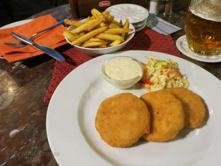 Three rounds of fried cheese, served up with tartar sauce and french fries with a beer to accompany it all.