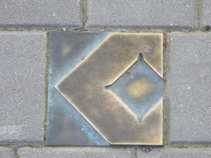 One of several bronze waymarkers to guide you across the centre.