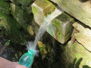 Collecting a bottle of cold, spring water in the spa park. Perfect refreshment on a hot day!
