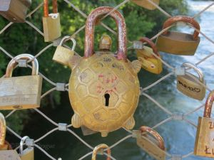 Love locks on a bridge in Graz, Austria. Signs of corrosion evident on all of them.