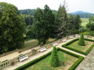 A view from a chateau balcony to the parkland surrounding it.
